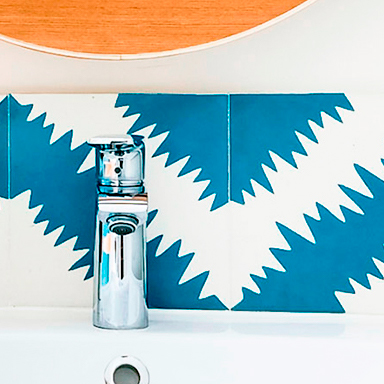 Colourful cement tiles in mordern bathroom in Paris