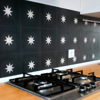 BLACK CEMENT TILES BACKSPLASH DESIGN WITH WHITE STARS AT KITCHEN IN LONDON