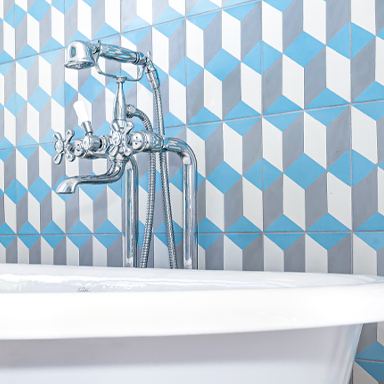 ENGLAND: BLUE ENCAUSTIC CEMENT TILE WALL IN A LUXURIOUS BATHROOM AT Maison de maître Charmes