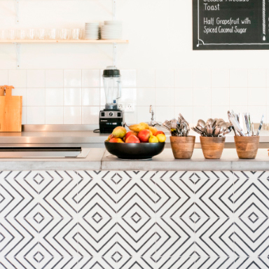 Encaustic tiles on modern restaurant bar
