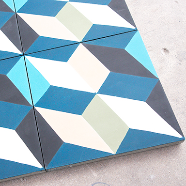 Modern cement tiles with a concrete background