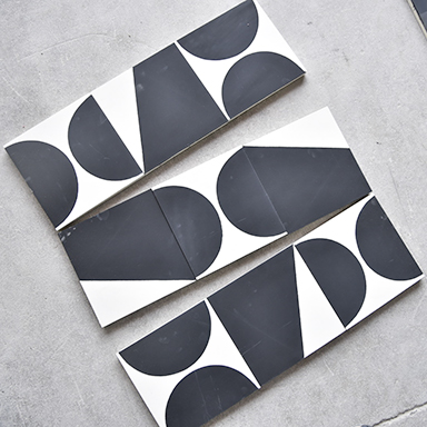 Modern cement tiles with geometric shapes and a concrete background