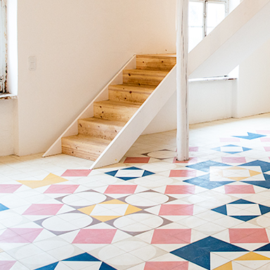 Colourful cement tile patchwork in an open room