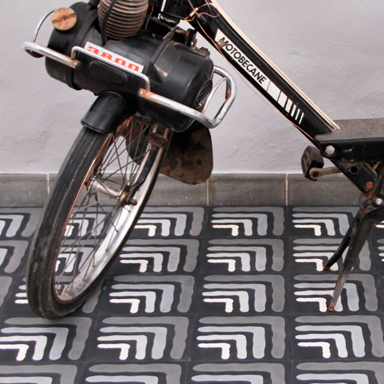 Encaustic tile floor on a terrace with a bike
