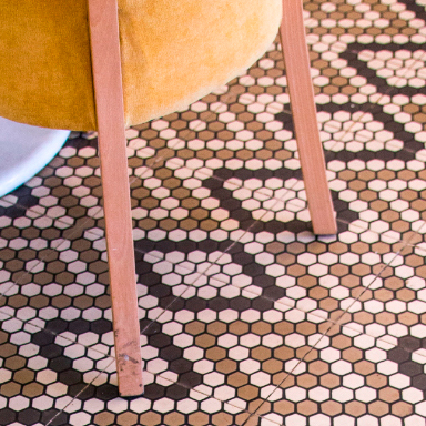 Modern cement tiles with hexagonal pattern design in restaurant floor at Milan